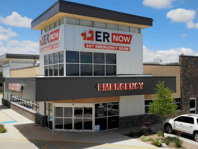 er now from the front with full building in view and parking lot