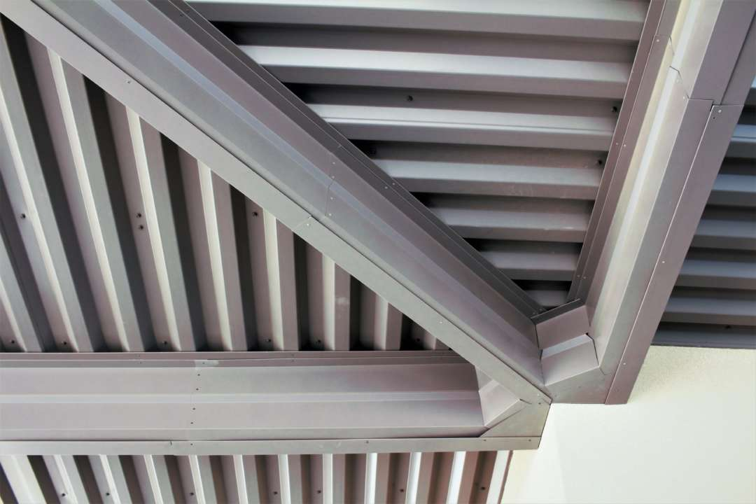 close shot of underneath awning meeting the outside corner of the psi building