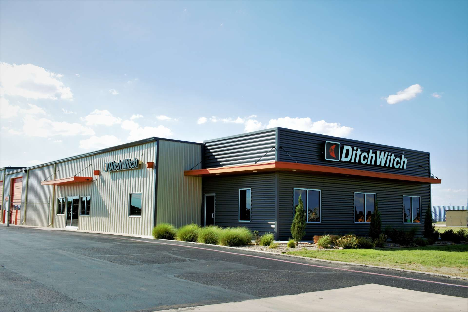 ditch witch building with light clouds in the back