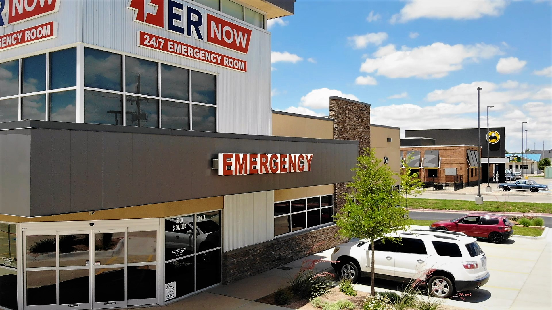 er now emergency room view from corner with buffalo wild wings in background