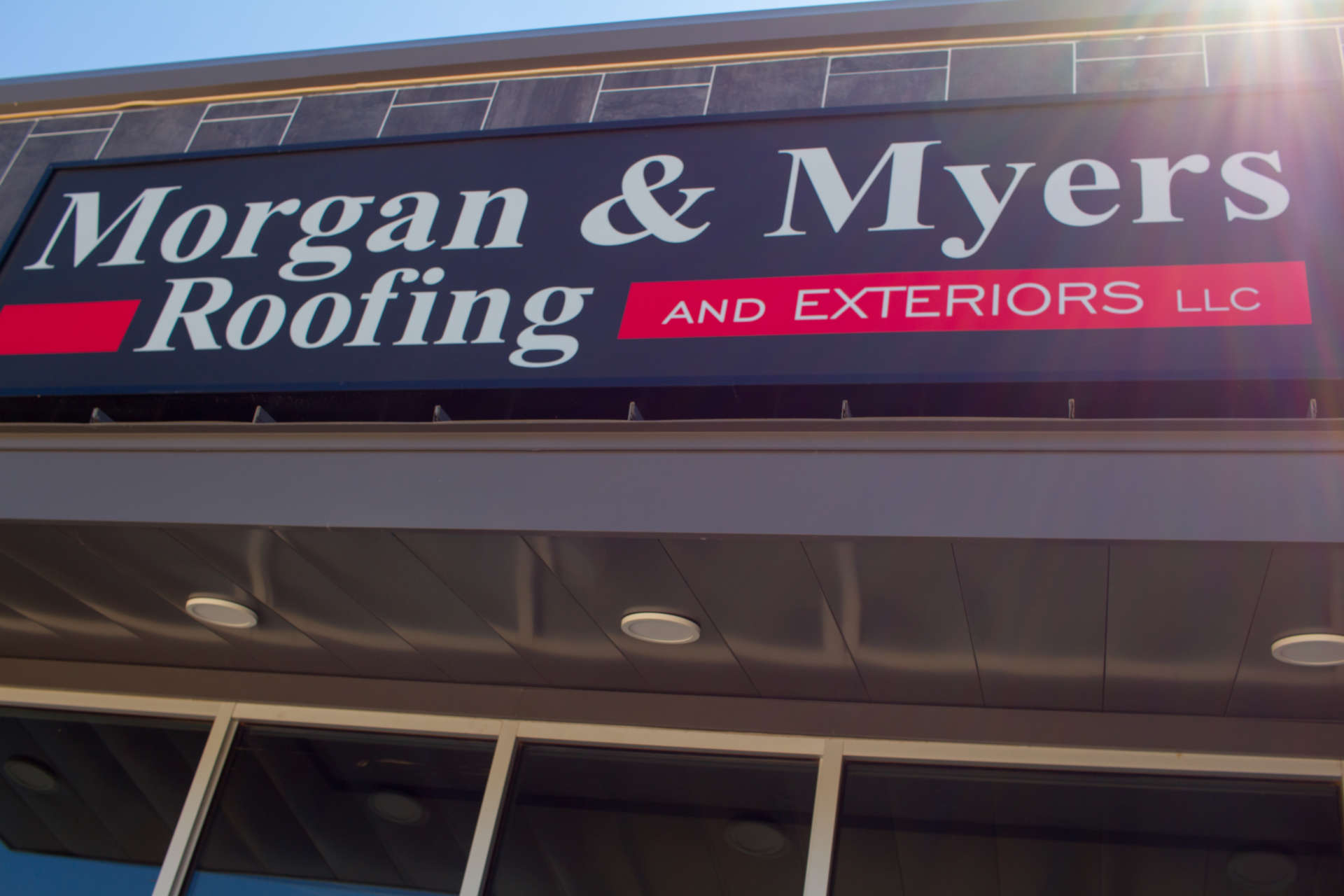 Morgan & Myers Roofing and Exteriors Signage above entrance with sunray
