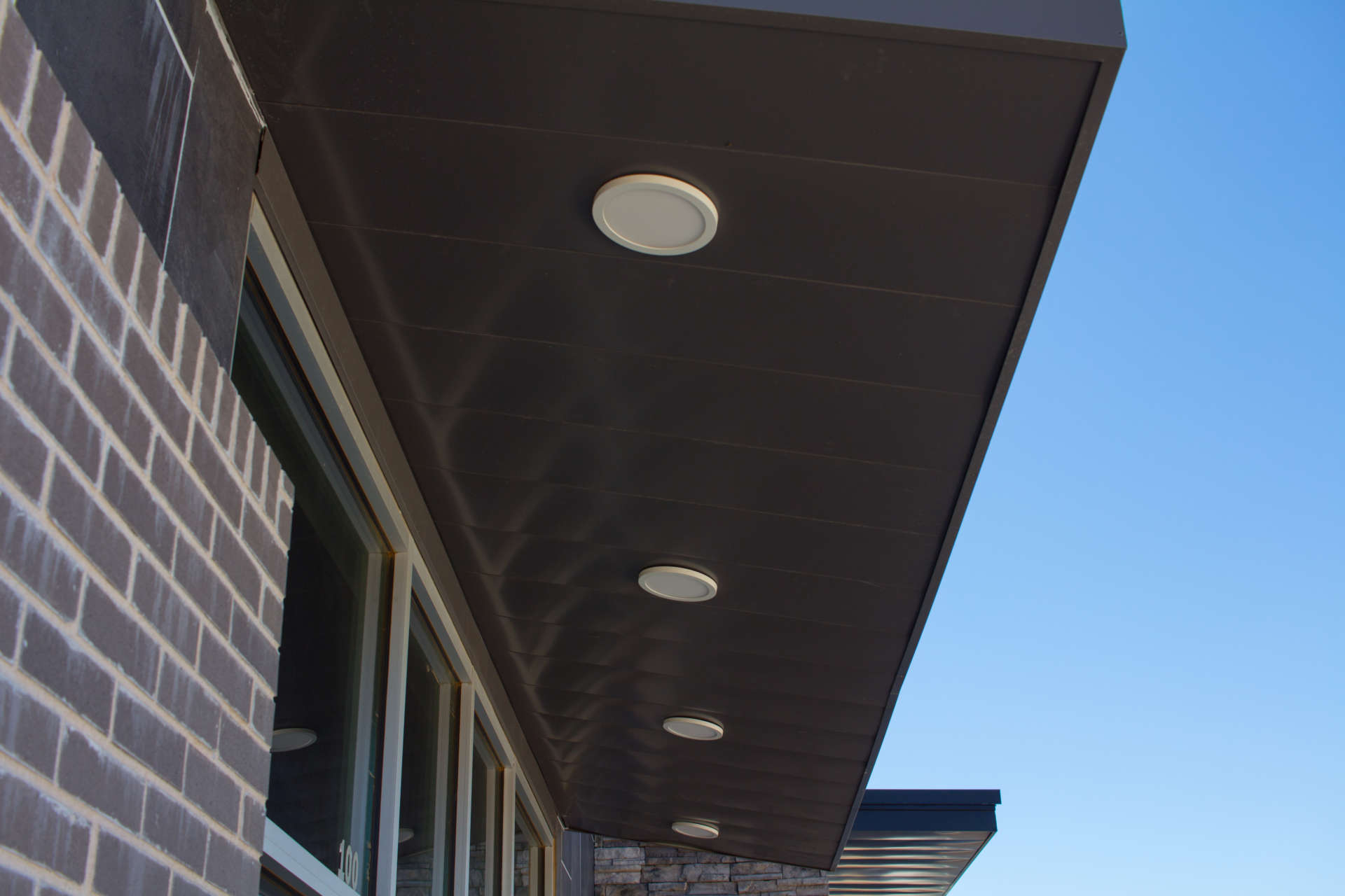 Morgan Myers close up custom awning with lights above entrance
