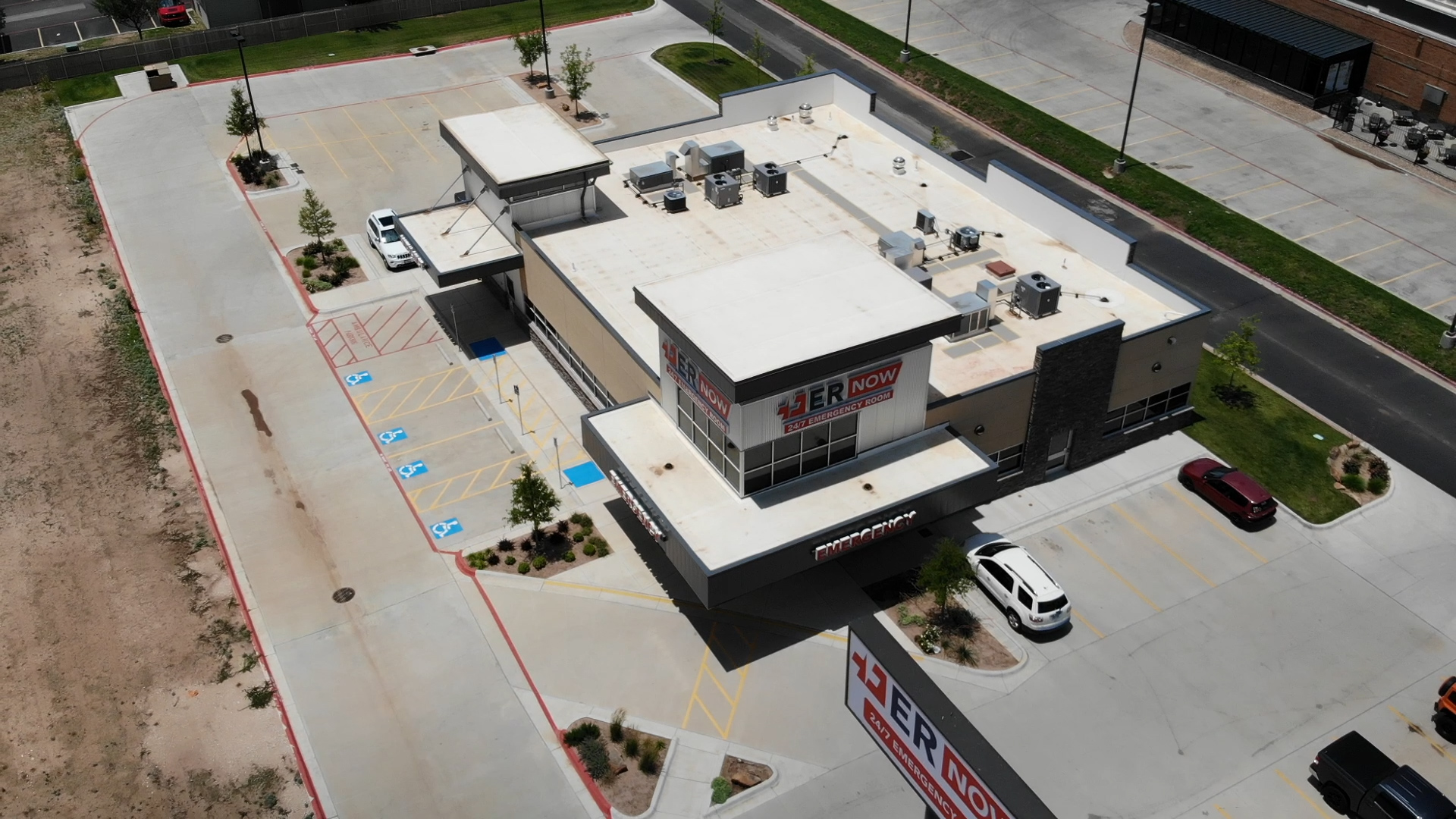 er now drone shot of roof and parking lot