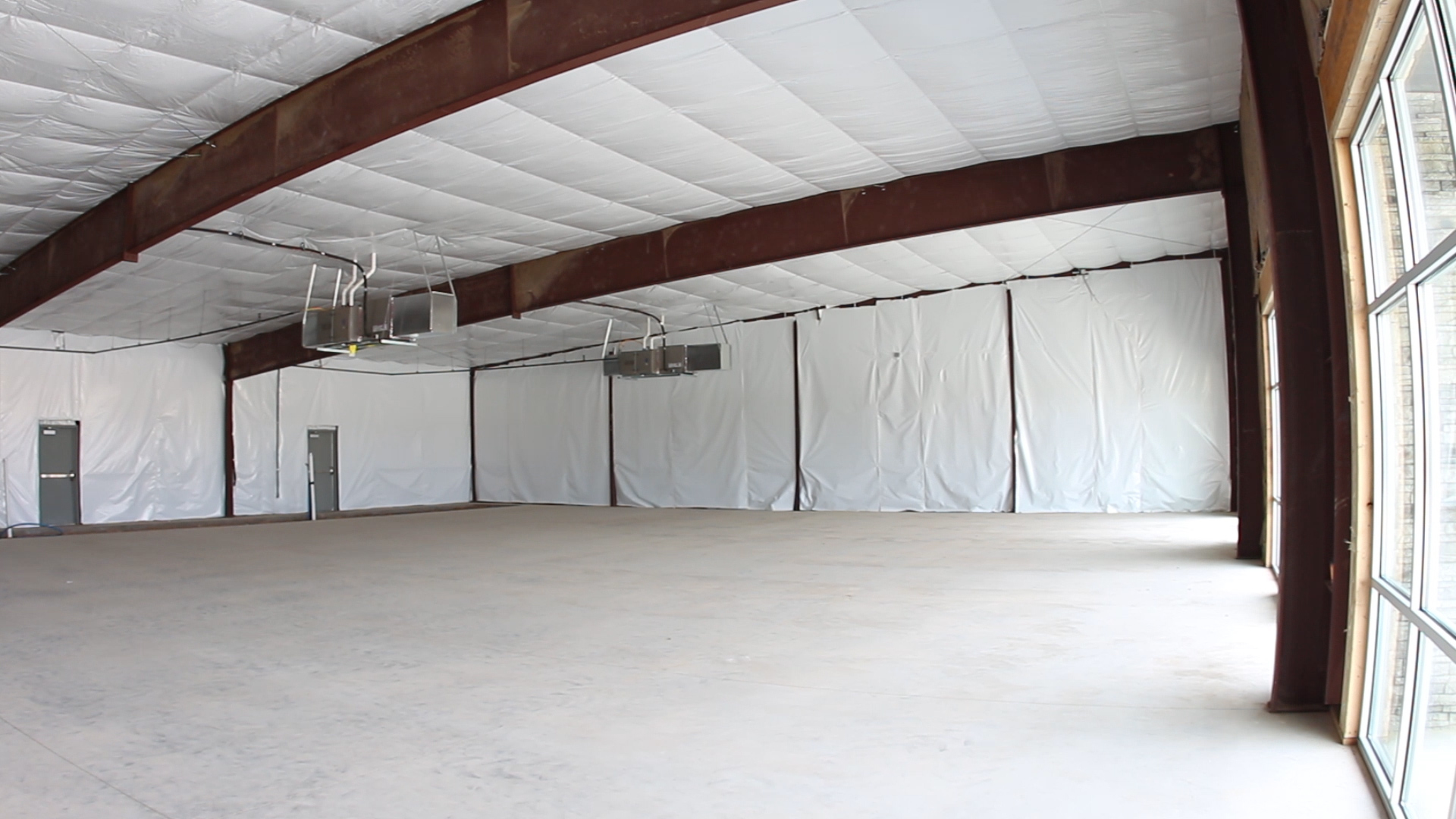 inside morgan myers available space with exposed beams